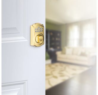 Schlage's BE365-CAM in Lifetime Polished Brass on door.