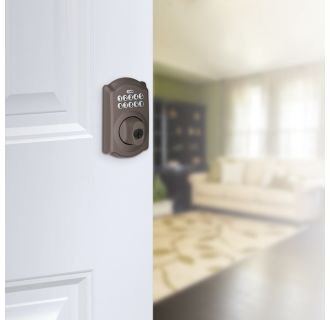 Schlage's BE365-CAM in Oil Rubbed Bronze on door.