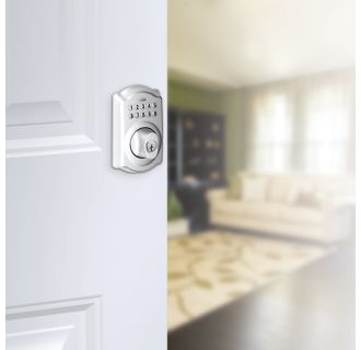 Schlage's BE365-CAM in Satin Chrome on door.